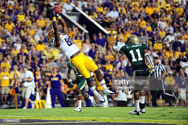 Jarvis Landry of the LSU Tigers catches a touchdown pass during a game against the UAB Blazers at Tiger Stadium on September 7, 2013 in Baton Rouge,...