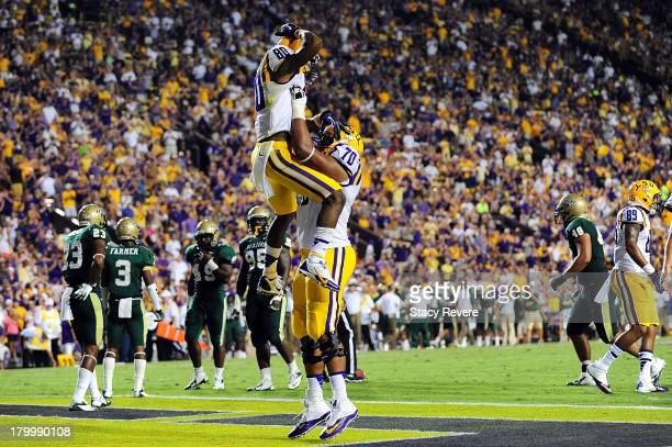 Jarvis Landry of the LSU Tigers celebrates a touchdown with La'el Collins during a game against the UAB Blazers at Tiger Stadium on September 7 2013...