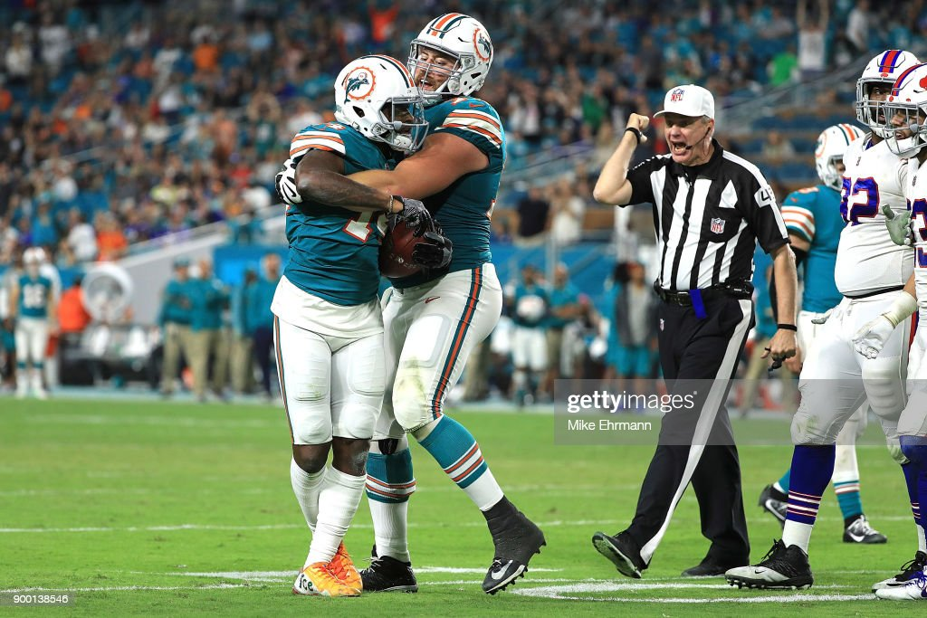 Jarvis Landry #14 of the Miami Dolphins being ejected from the game a fight at Hard Rock Stadium on December 31, 2017 in Miami Gardens, Florida.