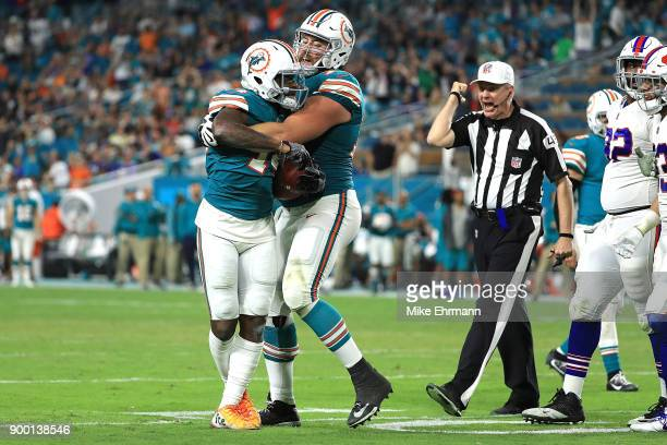 Jarvis Landry of the Miami Dolphins being ejected from the game a fight at Hard Rock Stadium on December 31 2017 in Miami Gardens Florida