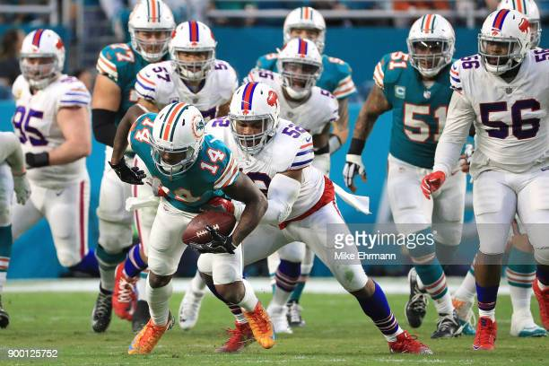 Jarvis Landry of the Miami Dolphins breaks away from a tackle during the second quarter against the Buffalo Bills at Hard Rock Stadium on December 31...