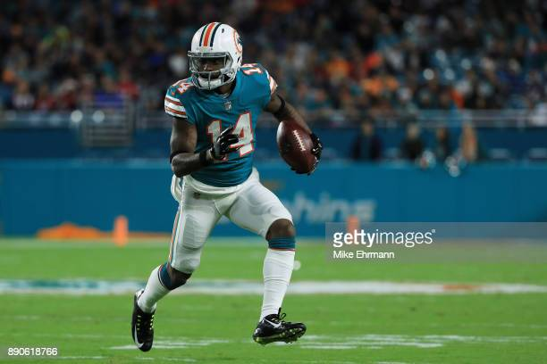 Jarvis Landry of the Miami Dolphins carries the ball in the first quarter against the New England Patriots at Hard Rock Stadium on December 11 2017...