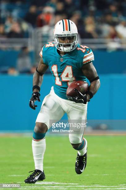 Jarvis Landry of the Miami Dolphins carries the ball in the third quarter against the New England Patriots at Hard Rock Stadium on December 11 2017...