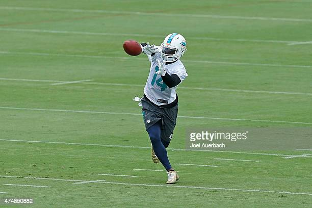 Jarvis Landry of the Miami Dolphins catches the ball during the teams first OTA's on May 26 2015 at the Miami Dolphins training facility in Davie...