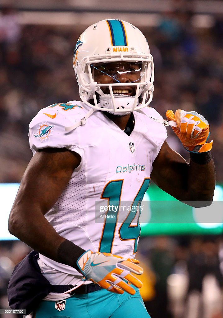 Jarvis Landry #14 of the Miami Dolphins celebrates after scoring a touchdown against the New York Jets during the third quarter of the game at MetLife Stadium on December 17, 2016 in East Rutherford, New Jersey.