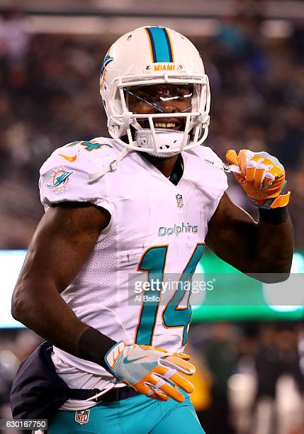 Jarvis Landry of the Miami Dolphins celebrates after scoring a touchdown against the New York Jets during the third quarter of the game at MetLife...
