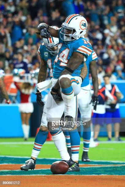 Jarvis Landry of the Miami Dolphins celebrates after scoring a touchdown during the third quarter against the New England Patriots at Hard Rock...