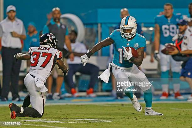 Jarvis Landry of the Miami Dolphins eludes the tackle by Ricardo Allen of the Atlanta Falcons as he runs with the ball during a preseason game on...