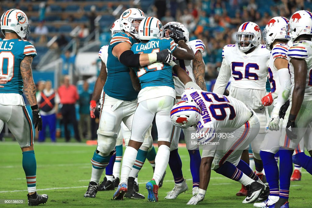 Jarvis Landry #14 of the Miami Dolphins getting into an argument with Jordan Poyer #21 of the Buffalo Bills in the fourth quarter at Hard Rock Stadium on December 31, 2017 in Miami Gardens, Florida.