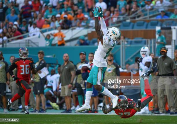 Jarvis Landry of the Miami Dolphins makes the catch in the third quarter against the Tampa Bay Buccaneers at Hard Rock Stadium on November 19 2017 in...
