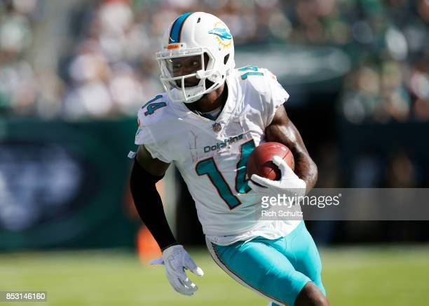 Jarvis Landry of the Miami Dolphins runs the ball against the New York Jets during the second half of an NFL game at MetLife Stadium on September 24...