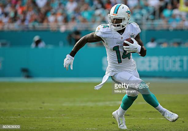 Jarvis Landry of the Miami Dolphins rushes after a catch during a game against the Indianapolis Colts at Sun Life Stadium on December 27 2015 in...