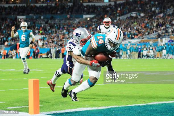 Jarvis Landry of the Miami Dolphins scores a touchdown in the second quarter against the defense of Jonathan Jones of the New England Patriots at...