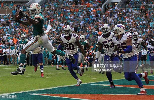 Jarvis Landry of the Miami Dolphins scores a two point conversion during a game against the Buffalo Bills at Hard Rock Stadium on October 23 2016 in...