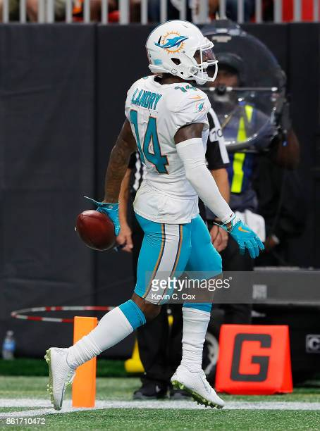 Jarvis Landry of the Miami Dolphins takes this reception in for a touchdown against the Atlanta Falcons at MercedesBenz Stadium on October 15 2017 in...