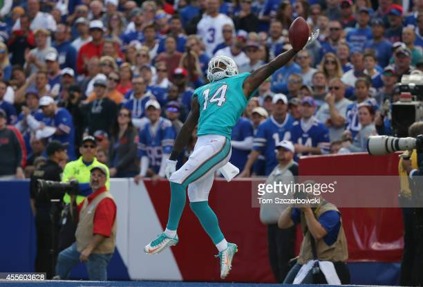 Jarvis Landry of the Miami Dolphins tries to catch a deep kick off during NFL game action against the Buffalo Bills at Ralph Wilson Stadium on...