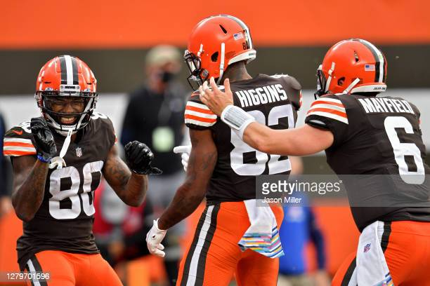Jarvis Landry, Rashard Higgins, and Baker Mayfield of the Cleveland Browns celebrate after scoring a touchdown in the second quarter against the...