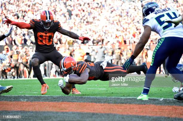 Jarvis Landry watches as Nick Chubb of the Cleveland Browns scores during the second half against the Seattle Seahawks at FirstEnergy Stadium on...