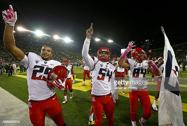 Jarvis McCall Jr #29 Jose Romero and Abraham Medivil of the Arizona Wildcats celebrates their 3124 victory over the Oregon Ducks at Autzen Stadium on...