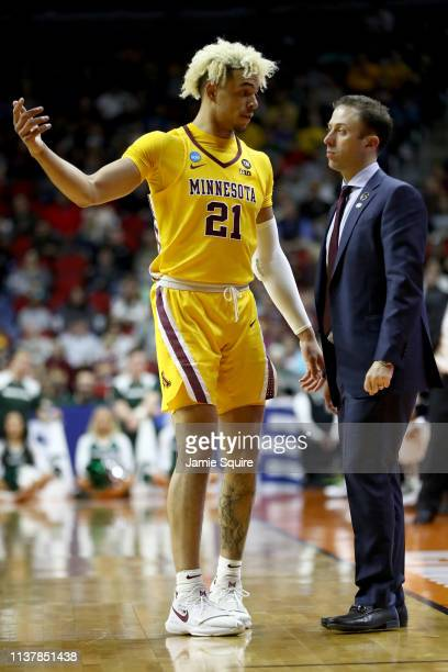 Jarvis Omersa of the Minnesota Golden Gophers talks with head coach Richard Pitino against the Michigan State Spartans during the second half in the...