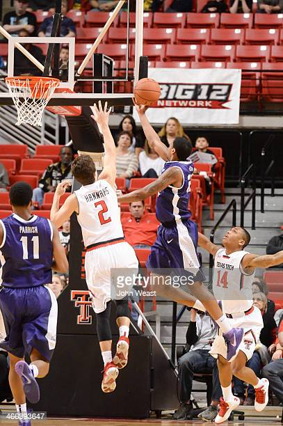 Jarvis Ray of the TCU Horned Frogs goes to the basket while being guarded by Dusty Hannahs of the Texas Tech Red Raiders during game action on...