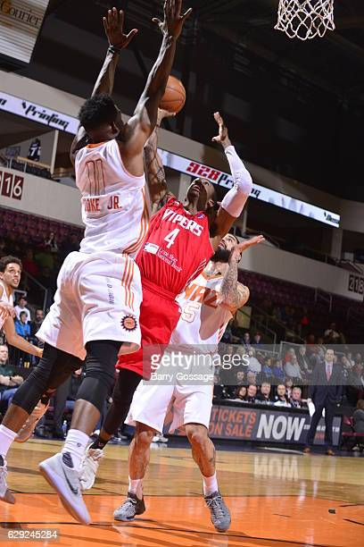 Jarvis Threatt of the Rio Grande Valley Vipers shoots against Derek Cooke Jr #11 of the Northern Arizona Suns on December 9 at Prescott Valley Event...