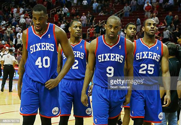 Jarvis Varnado James Nunnally James Anderson and Elliot Williams of the Philadelphia 76ers walk off the court after losing to the Houston Rockets...