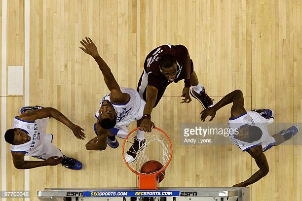 Jarvis Varnado of the Mississippi State Bulldogs dunks against Perry Stevenson of the Kentucky Wildcats during the final of the SEC Men's Basketball...