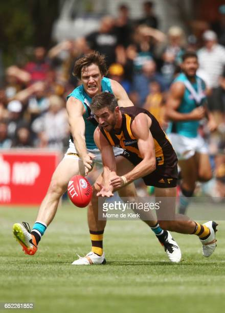 Jaryd Polec of the Power and Ricky Henderson of the Hawks compete for the ball during the JLT Community Series match between the Port Adelaide Power...