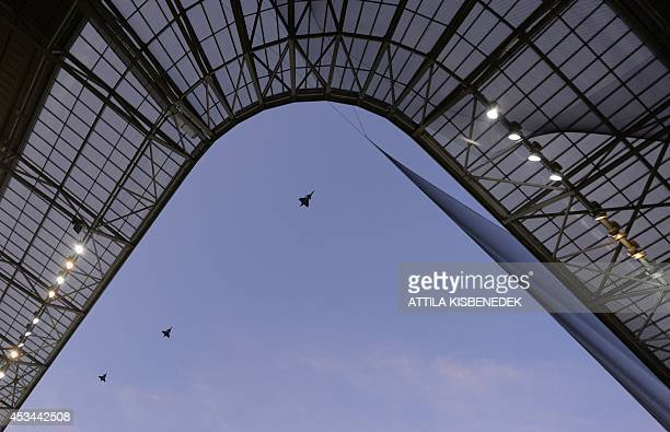 Jas 39 Gripen fighters of Hungarian Air Force fly over the Groupama Arena new football stadium in Budapest prior to the first international football...