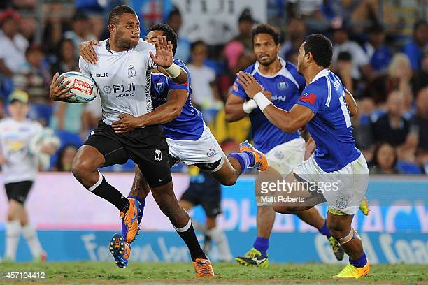 Jasa Veremalua of Fiji is tackled in the Cup Final against Samoa during the Gold Coast Sevens the first round of the HSBC Sevens World Series at Cbus...