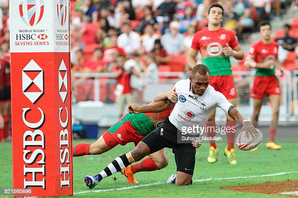 Jasa Veremalua of Fiji scores a try against Portugal during the 2016 Singapore Sevens at National Stadium on April 16 2016 in Singapore