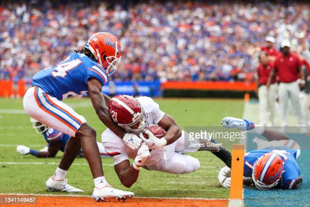 Jase McClellan of the Alabama Crimson Tide dives for a touchdown during the first quarter against the Florida Gators at Ben Hill Griffin Stadium on...