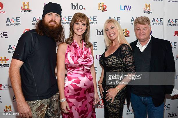 "Jase Robertson and Missy Robertson of ""Duck Dynasty"" pose with Laura Dotson and Dan Dotson of ""Storage Wars"" at the A+E Networks 2013 Upfront on May..."