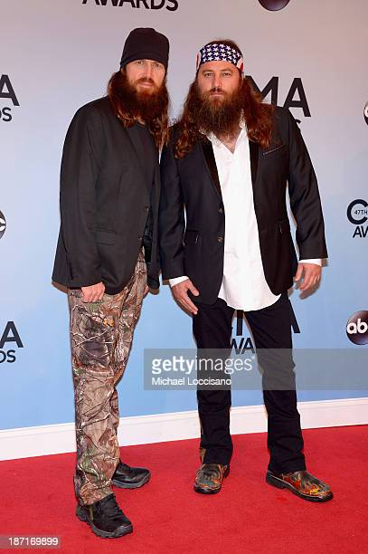 Jase Robertson and Willie Robertson attend the 47th annual CMA Awards at the Bridgestone Arena on November 6 2013 in Nashville Tennessee
