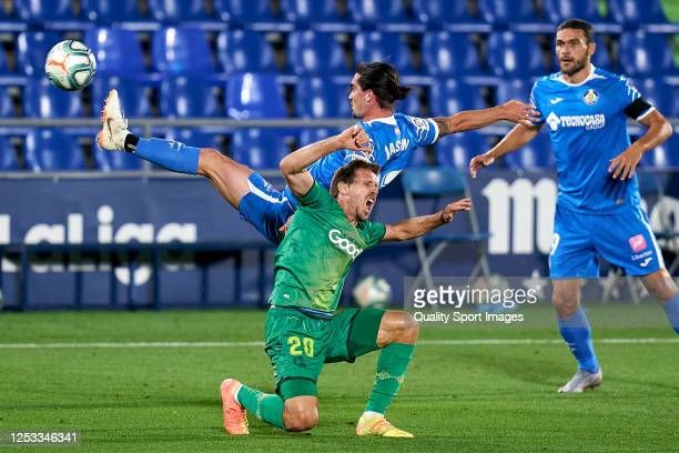 Jasen of Getafe CF battles for the ball with Nacho Monreal of Real Sociedad during the Liga match between Getafe CF and Real Sociedad at Coliseum...