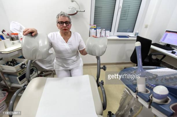 Jasenka Grujic a Zagrebbased gynaecologist and a prominent voice for reproductive rights poses on February 13 at her private clinic in Zagreb...