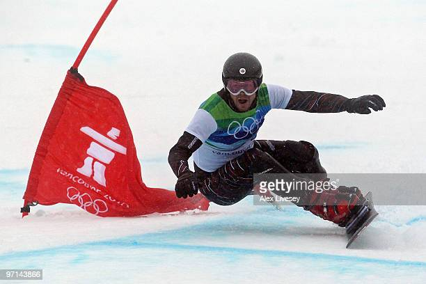 Jasey Jay Anderson of Canada reacts competes during the Snowboard Men's Parallel Giant Slalom on day 16 of the Vancouver 2010 Winter Olympics at...