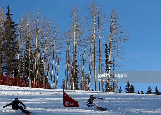 JaseyJay Anderson of Canada races Mathieu Bozzetto of France in the Snowboard FIS Parallel Giant Slalom World Cup 2010 on December 15 2009 in...