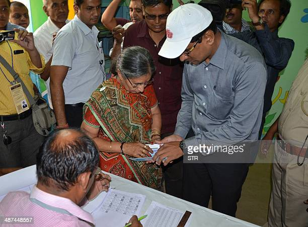 Jashodaben Modi wife of Gujarat Chief Minister and Bhartiya Janta Party Prime ministeral Candidate Narendra Modi arrives to cast her vote in a...