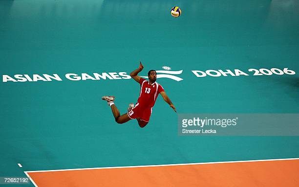 Jasim Al Nabhan of Bahrain serves the ball during the Men's Team Tournament Qualifications Pool A match between Bahrain and Lebanon at the Volleyball...