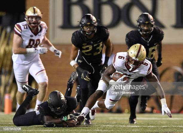 Ja'Sir Taylor of the Wake Forest Demon Deacons tackles Jeff Smith of the Boston College Eagles during their game at BBT Field on September 13 2018 in...