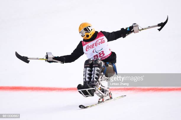 Jasmin Bambur of United States reacts after crossing the finish line during the Alpine Skiing Men's SuperG Sitting at the Jeongseon Alpine Centre...