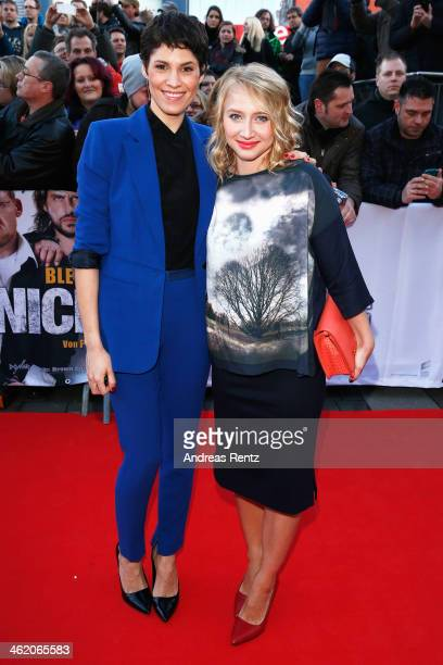 Jasmin Gerat and Anna Maria Muehe attend the world premiere of the film 'Nicht mein Tag' at UCI cinema on January 12, 2014 in Bochum, Germany.