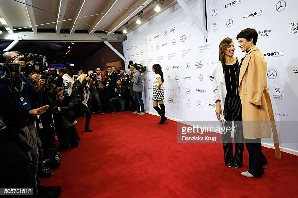 Jasmin Gerat and Aylin Tezel attend the Marc Cain show during the Mercedes-Benz Fashion Week Berlin Autumn/Winter 2016 at Brandenburg Gate on January...