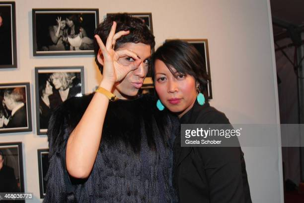 Jasmin Gerat and Minh-Khai Phan-Ti pose like in the photo behind them at the Bild 'Place to B' Party during the 64th Berlinale International Film...