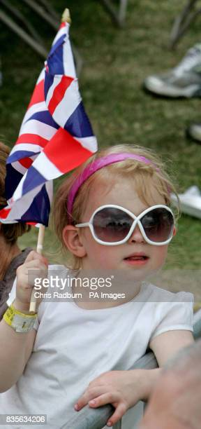 Jasmin Holly Baker waves a Union Jack Flag at during the Armed Forces Day at the Historic Dockyard in Chatham Kent