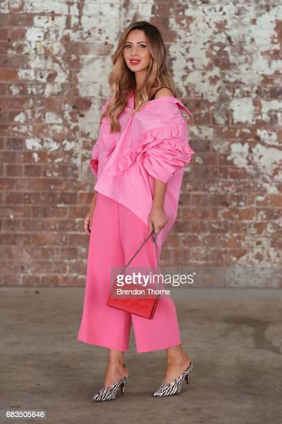 Jasmin Howell wearing Parosh via Farfetch pants, Storets top, Balenciaga shoes & Gucci bag during Mercedes-Benz Fashion Week Resort 18 Collections at...