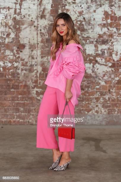 Jasmin Howell wearing Parosh via Farfetch pants Storets top Balenciaga shoes Gucci bag during MercedesBenz Fashion Week Resort 18 Collections at...