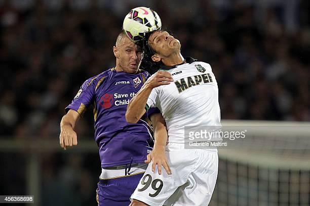 Jasmin Kurtic of ACF Fiorentina in action and Sergio Floccari of US Sassuolo Calcio during the Serie A match between ACF Fiorentina and US Sassuolo...